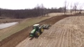 Harvest. Food industry. Agriculture. Agricultural work. Farming tractor. Green field, agricultural works. Aerial view 76685154