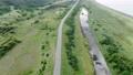 A straight road in Hokkaido 76685549