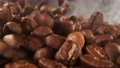 Super slow motion of coffee beans pile with camera move. Filmed on high speed cinema camera. 76713250