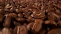 Super slow motion of coffee beans pile with camera move. Filmed on high speed cinema camera. 76713251