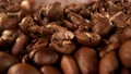 Super slow motion of falling coffee beans with camera move. Filmed on high speed cinema camera, 1000fps. 76713566