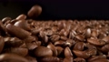 Super slow motion of falling coffee beans with camera move. Filmed on high speed cinema camera, 1000fps. 76713568