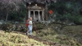 European tourist walks down hillside after visiting Lycian rock tombs in Fethiye, Turkey, in early spring. 76722882