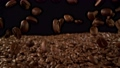 Super slow motion of falling coffee beans with camera move. Filmed on high speed cinema camera, 1000fps. 76723079