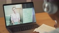 African girl sits at a desk and study online using a laptop, a schoolgirl learns in a remote lesson by video call with a teacher, education in the conditions of the coronovirus pandemic, math lesson. 76738299