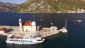 Top view of the Our lady of the Rocks island, yachts and tourist boat near it in the Bay of Kotor  76738473