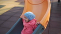 Child. Little girl play on playground. Slide and have fun 76744200