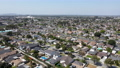 Aerial view of Lakewood middle class neighborhood, city in Los Angeles County, California 76759324