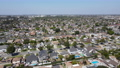 Aerial view of Lakewood middle class neighborhood, city in Los Angeles County, California 76759326