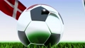 Seamless looping 3d animation of a soccer ball reflecting the flags of Wales and Denmark in 4K resolution 76767744
