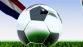 Seamless looping 3d animation of a soccer ball reflecting the flags of Wales and Netherlands in 4K resolution 76767752
