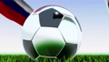 Seamless looping 3d animation of a soccer ball reflecting the flags of Wales and Russia in 4K resolution 76767755