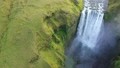 Skogafoss, Iceland's famous Ring Road waterfall. Aerial drone view of the magnificent natural wonder  76774903