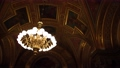 Large golden chandelier under the gilded ceiling in the interior. 76783391