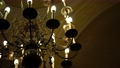 Black metal chandelier in baroque style with ceiling and candle light bulbs. 76783392