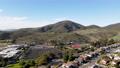 Aerial view of Carmel Mountain neighborhood with Black Mountain. San Diego 76803717