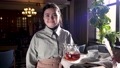 Waitress with tray standing in cafe 76807646