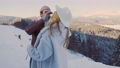 couple in winter in the mountains 76840690
