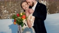 bride and groom in winter in nature 76840691