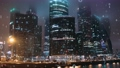 Motion graphics, symbol visualization of the binary number system, view of skyscrapers in fog on background, night city timelapse. 76847816