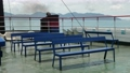 Empty ferry boat with blue bench seats 76852465