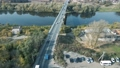 Traffic on a two-lane road bridge from a birds eye view.  76853471