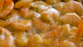 Close up video of fried king prawns are preparing on iron pan, seafood, cooking process, healthy eating concept 76858258