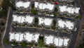 Aerial view of middle class townhouse and residential condos in San Diego 76868706
