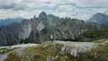 Aerial view of women hiking close to Auronzo di Cadore of Cadini di Misurina mountains group in Dolomites, Italy, part of Tre Cime di Levaredo national park and UNESCO world heritage site. 76872920