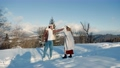 couple in winter on the mountain 76874503