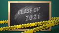 Class of 2021. Lettering in a school blackboard. Covid-19 concept. 76877197