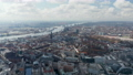 Wide aerial view of Hamburg cityscape with residential apartment buildings and old churches and historic landmarks 76896507