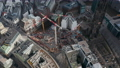 Descending aerial view of cranes and construction equipment near St. Nikolai world war Memorial church ruins in Hamburg city center 76896516