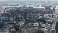 Aerial view of Hamburg city center with St. Nikolai Memorial church ruins among residential houses by the river 76897796