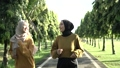 two girls in veil do outdoor sports while jogging together 76918555