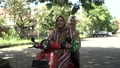 happy muslim girls riding scooter enjoy summer vacation 76918557