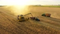 Combine harvesting wheat field gold farm aerial 76956464