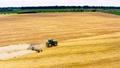 Combine harvesting wheat field gold farm aerial 76956475