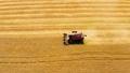 Combine harvesting wheat field gold farm aerial 76956481