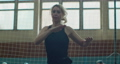 Fitness trainer preparing for jogging, student trainer exercising. Woman is doing jumping jeg exercise. Sport and fitness, training, workout concept. 76981511