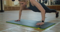 Slimming caucasian woman doing gym routine. Fit model does push ups as a part of training session - healthy lifestyle concept. 76982349
