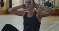 Sportswoman is doing abs exercises on a mat and doing sit-ups in gym. Muscular female athlete is doing abs workout. 76982351
