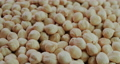 Slider shot: The background of the cleaned hazelnuts is a healthy and delicious ingredient in confectionery products and pastries 76984845