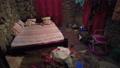 African Bedroom Inside a Slum Home, Dark Room with Bare Stone Wall, Zanzibar 76994024