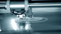 3D printer printing a model in the form close-up. The concept 76999694