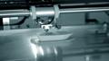 3d printer prints orange object close-up. Automatic three dimensional 3D printer 76999695