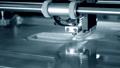 3d printer prints object close-up. Automatic three dimensional 3D printer 76999699