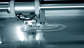 3D printer works and creates an object from hot molten plastic close-up. 76999700
