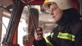 Fireman in cabin check data in digital tablet 77007388