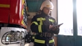 Fireman in cabin check data in digital tablet 77007396